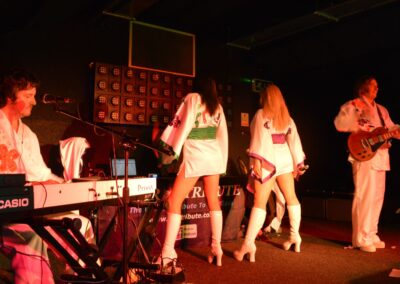 Doing a dance routine on stage