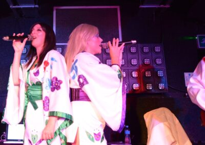 A singing duet performing Abba on stage