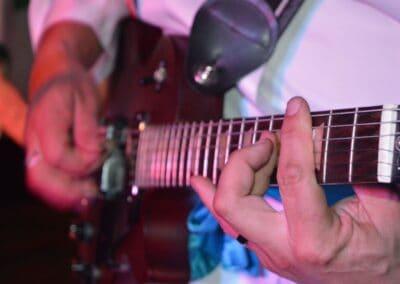 A close up of a guitar being strummed