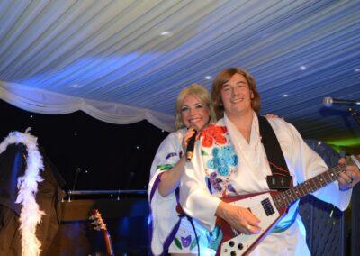 A flying V guitar being strummed with a singer