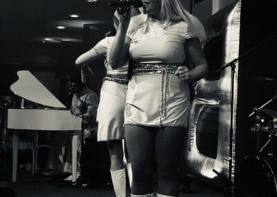 The singer of ABBA Rebjorn singing an Abba song on stage