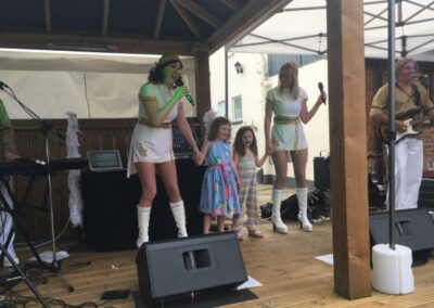 ABBA Rebjorn on stage with two children